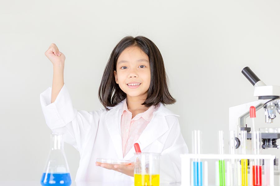 girl enjoying primary 6 science tuition experiment in class