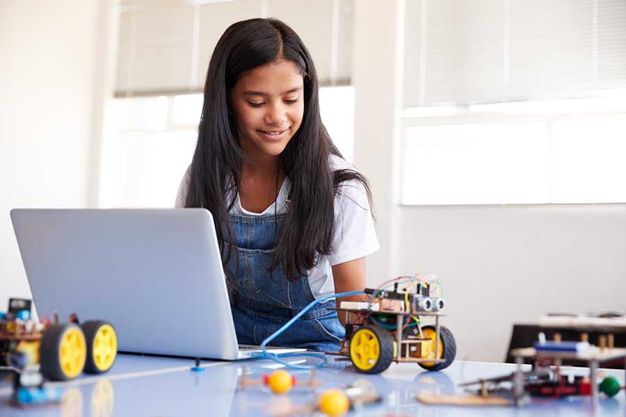 girl experimenting with robotics and engineering