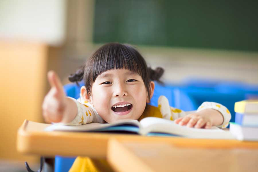 happy student giving thumbs up at tuition center