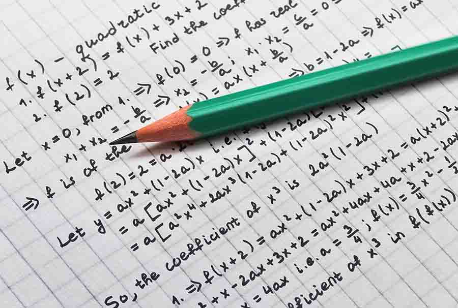 long algebra equations being worked on paper