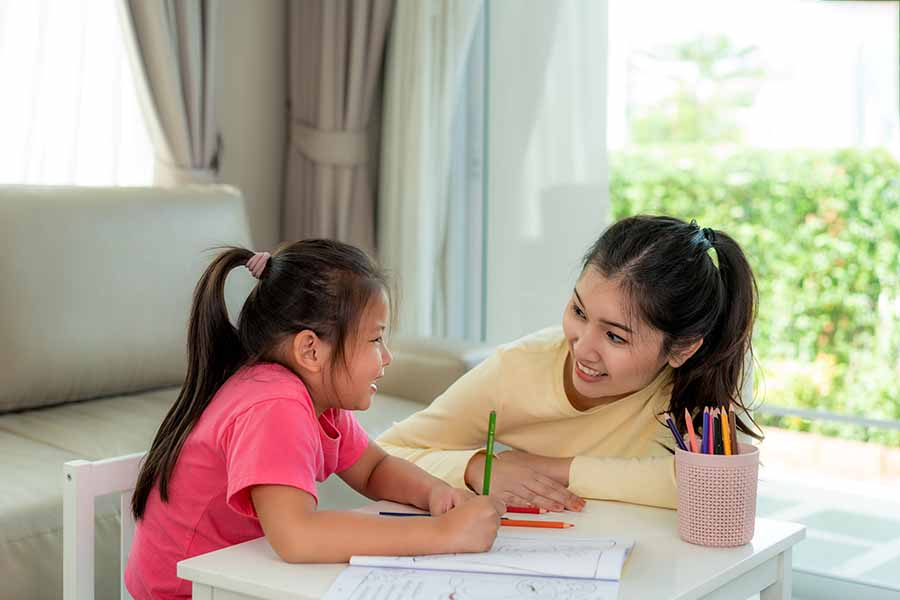 private primary level tuition Singapore with cheerful tutor and student