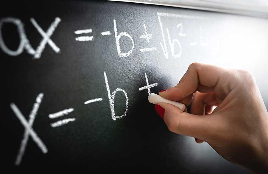 simply algebra equations written on blackboard